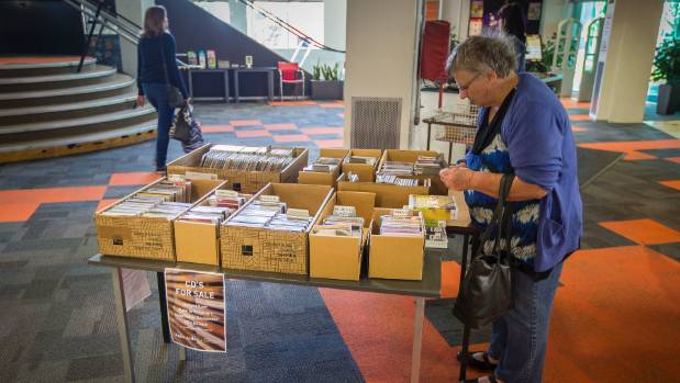 A potential buyer searches for a bargain at New Plymouth's Puke Ariki library.