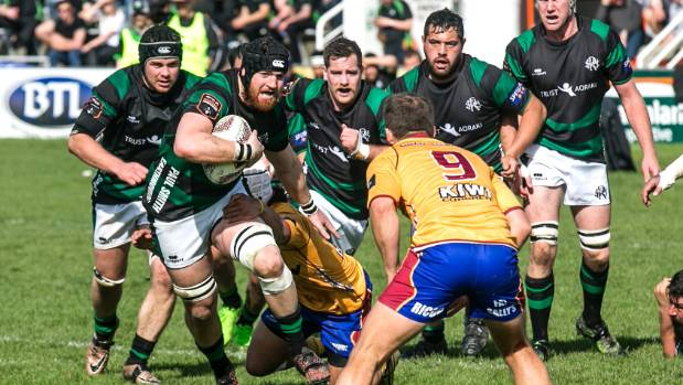 South Canterbury captain Kieran Coll charges towards North Otago halfback Robbie Smith in the Heartland Championship.