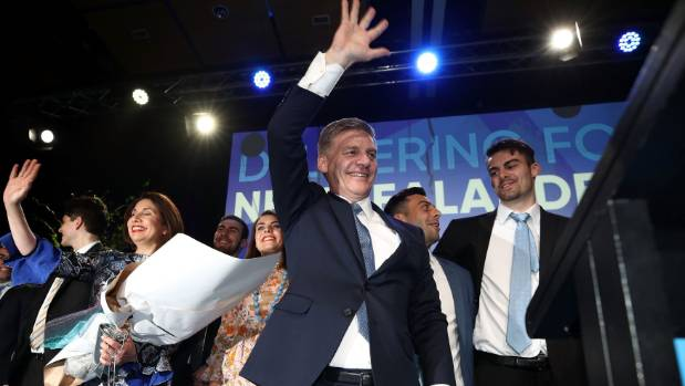 National leader Bill English waves to his supporters at the party's election night function.