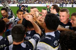 The Cowboys celebrate victory during the NRL Preliminary Final match.