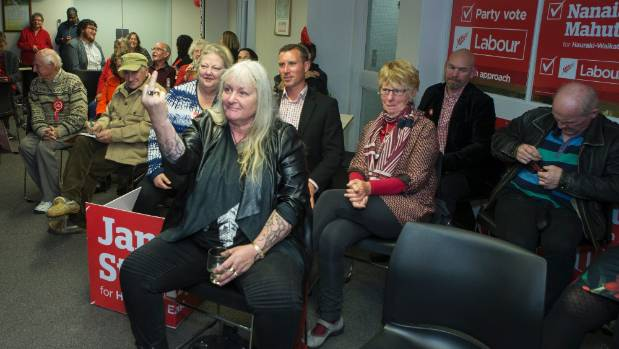 Hamilton Labour Party supporters respond to National Party Deputy Leader Paula Bennett on the TV screen during Election 2017.