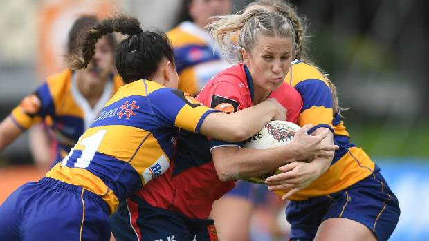 Tasman fullback Jess Drummond attempts to hit the ball up against Bay of Plenty.