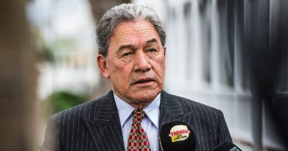Winston Peters speaks to media outside The Duke Of Marlborough Hotel in Russell on Sunday.
