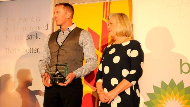 Todd Velvin is presented with the DHL Instructor of the Year Award by DHL's Pip Cucksey.