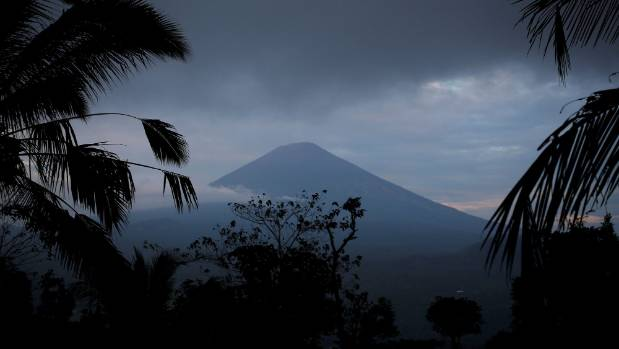 Almost 35000 flee rumbling Bali volcano