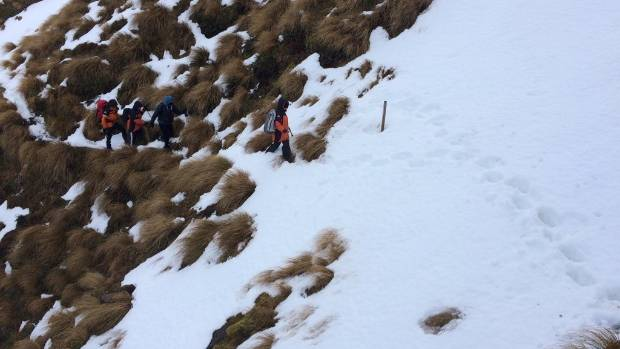 Four walkers were rescued off Mt Taranaki's Upper Dive Lake Track after facing thigh-deep snow.