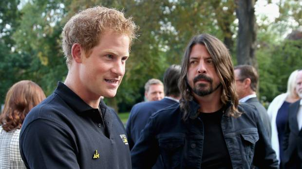 Prince Harry and Foo Fighters' front man Dave Grohl have an unusual shared history.