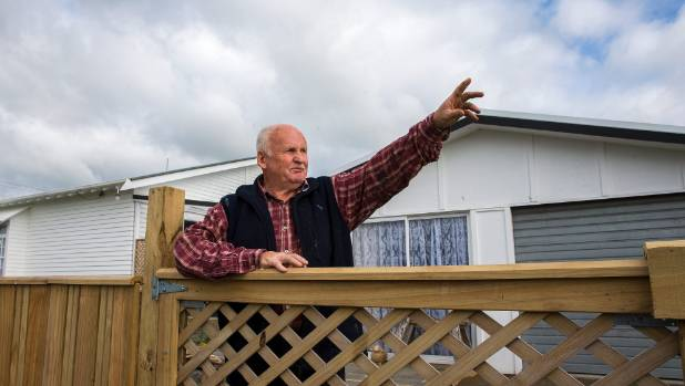Sanson resident Bill Tooley points to where fighter jets have been flying over his home.