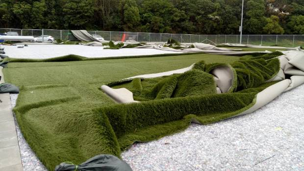 Blustery Wellington winds have blown Karori's recently laid artificial turf into a shambles.