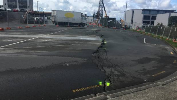 A subsidence in a Birkenhead car park has created even more headache for ongoing row between local business owners and ...