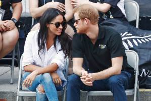 Prince Harry arrives with girlfriend actress Meghan Markle at the wheelchair tennis event during the Invictus Games in ...