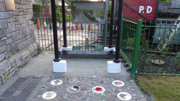 Old railway signal weights were painted by school children for a new memorial on the Bere Ferrers station platform.