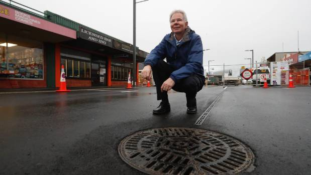 Tasman District Council project manager Jeff Robinson in the centre of a newly completed section of Queen St.