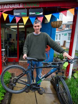 Green Bikes general manager Peter Cooke likes giving old bicycles a new lease of life.
