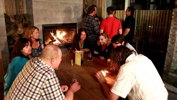 A crowd enjoys the outside fire at New Plymouth's Snug Lounge. (file photo).