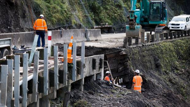 Contractors fix the damaged Manawatū Gorge road in May, before it was deemed unsafe for workers.