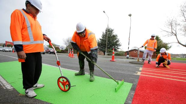 Civil Works and Construction Ltd, of Christchurch, works on the new trial pedestrian crossing at James Hargest College ...