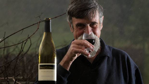 Nick Dymock with his unique Totara Reserve red wine.