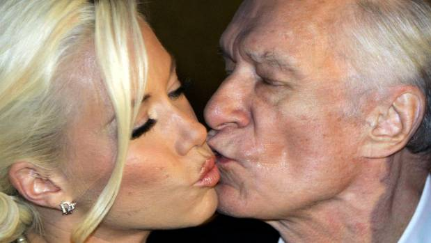 Playboy magazine founder Hugh Hefner kisses girlfriend Kendra Wilkinson after their arrival for his 80th birthday party ...