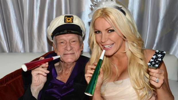 Octogenarian Playboy founder Hugh Hefner poses with his wife Crystal Harris as they ring in the new year at their ...