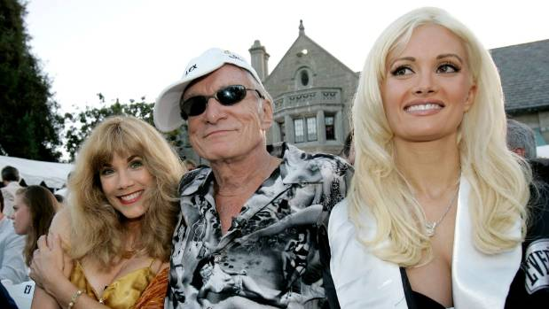 Hugh Hefner is joined by former girlfriends Barbi Benton (L), and Holly Madison, during a party at the Playboy Mansion ...