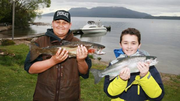 Te Tai Wipani Clendon-Smallman, 9, and Joel Taylor, 12, catch some whoppers on opening day of the trout fishing season ...