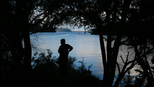 Te Tai Wipani Clendon-Smallman, 9, takes in the view near The Landing at Lake Tarawera.