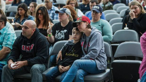 Las Vegas shooting: Hymns and prayers break out as vigil ends