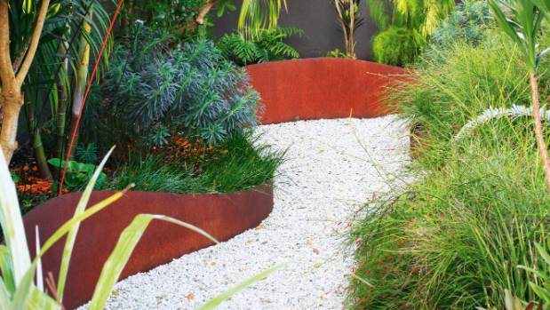 Alpine Mix pebbles light up the garden path as it meanders slowly through the foliage; the soft feathery reed horsetail ...