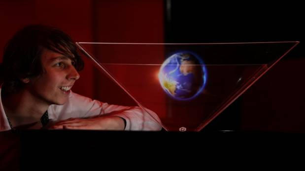 Mather gazes at a 3D globe using the HoloSpace hologram projector, which combines 3D visualisation with interactive ...