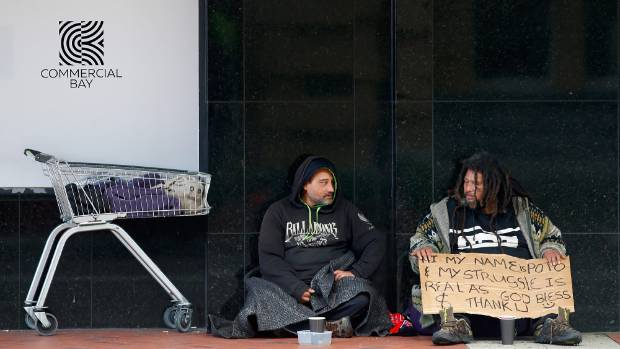 Homeless people beg for money in Auckland's CBD.