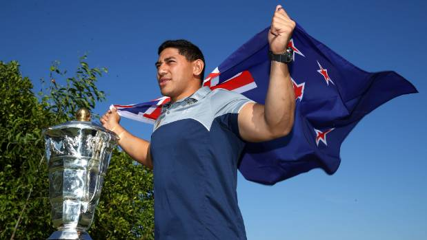 Jason Taumalolo poses with the New Zealand flag and Rugby League World Cup in June. He decided to abandon the Kiwis for ...