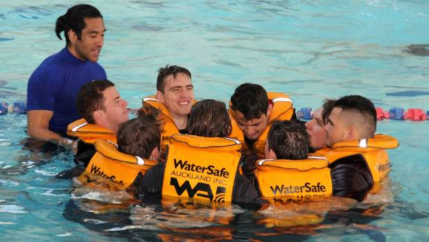 Drowning Prevention Auckland's Harry Aonga instructs the blokes to form a huddle to keep each other afloat and warm in ...