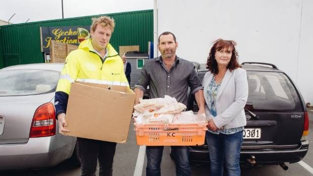 Dropping off the goods at John's Kitchen, from left, Rob Lane, Rick Alderlieste and Lisa Coyle.