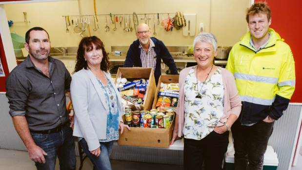Good times at John's Kitchen as Janette Walker, second from right, receives boxes of food from Constellation staff, from ...