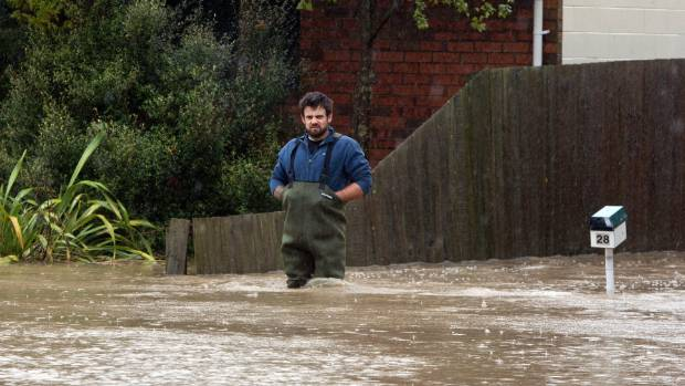 Adam Peat waiting out the floods in 2014.