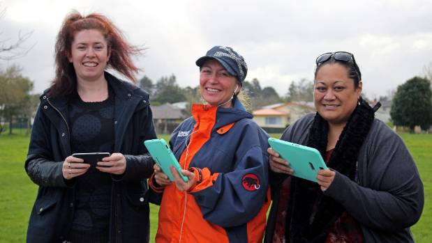Auckland Council activities adviser for young people Claire Beuvink, left, Geo AR Games developer Melanie Langlotz, and ...
