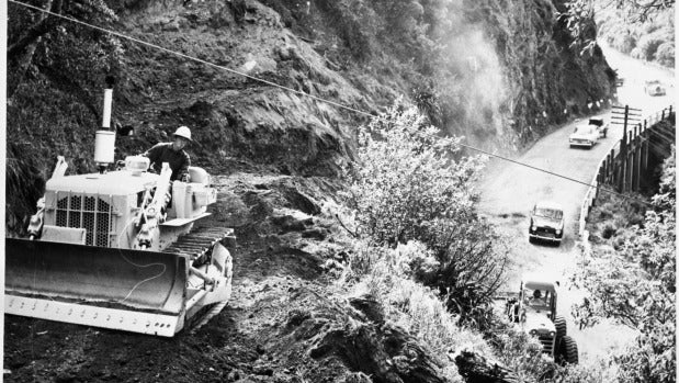 Bulldozer driver Lawrence Gudsell, cutting back the cliff face in 1969.