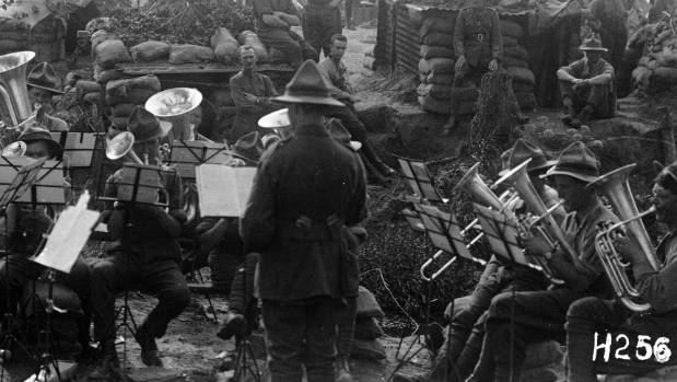 A brass band performs at a New Zealand Rifle Brigade camp near the line at Ypres, September 1917.