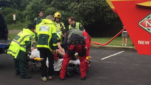 A man suffered leg injuries after falling from a rocky cliff in Piha, Auckland.