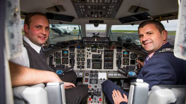 New Plymouth mayor Neil Holdom, right, with Originair pilot Warwick Wild on board the airlines Jetstream 31 Origin Air ...