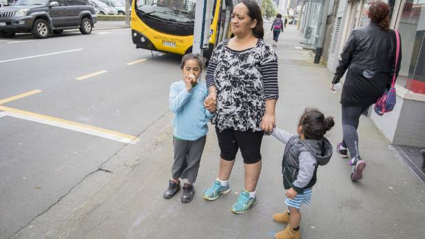 Rangi Ngerengere, with son Jacob Williams, right, and niece Hariata Olsen, says Wellington's bus fares are too expensive.