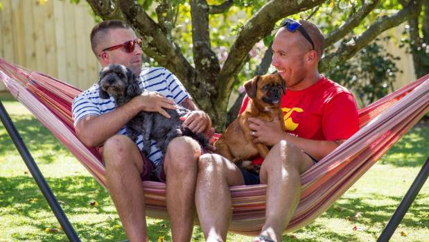 Tāmati Coffey, his partner Tim Smith and their dogs.