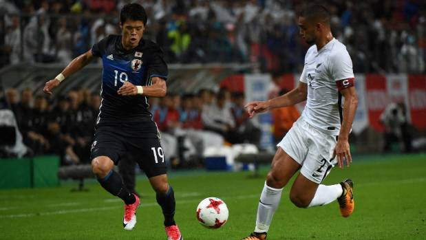 New Zealand's Winston Reid and Japan's Hiroki Sakai of Japan compete for possession at Toyota Stadium.