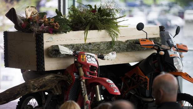 Richard Ebbett's casket was held up by two motocross motorcycles at his funeral in Palmerston North on Saturday.