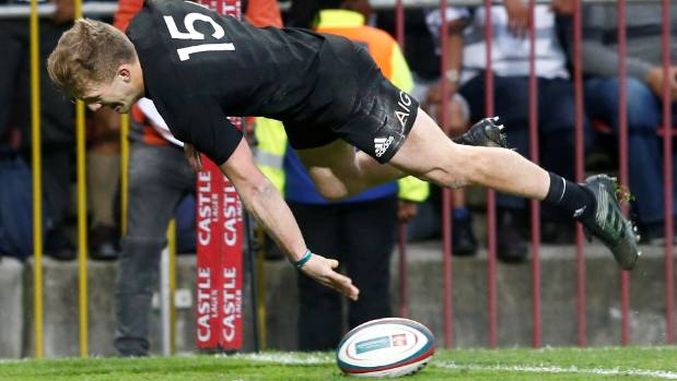 Damian McKenzie gets some air after scoring a try during the All Blacks' 25-24 victory over the Springboks in Cape Town.