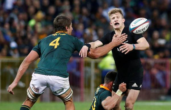 All Blacks fullback Damian McKenzie loses control of the ball in the tackle.