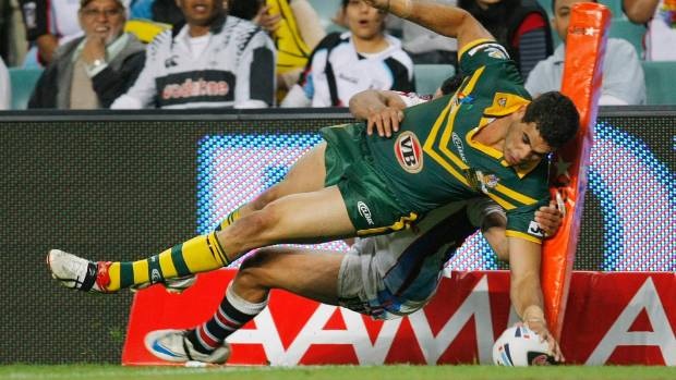 Fiji's Jarryd Hayne attempts to tackle Australia's Greg Inglis during the 2008 Rugby League World Cup.