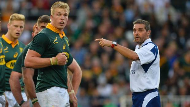 Referee Jerome Garces, pictured speaking to Pieter-Steph du Toit, sent off Damian de Allende for a dangerous late tackle.