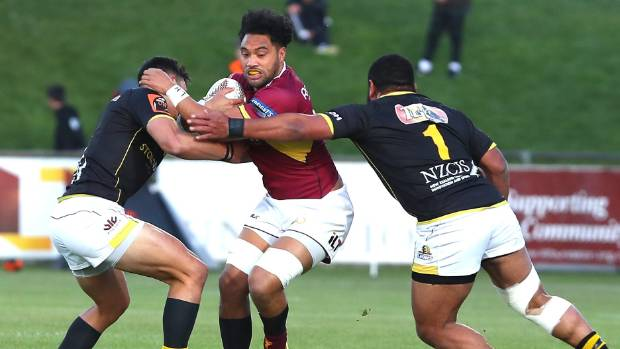 Southland Stags player Tupou Sopoaga takes on the Wellington defence at Rugby Park.